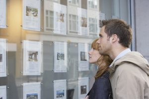 Couple looking at properties